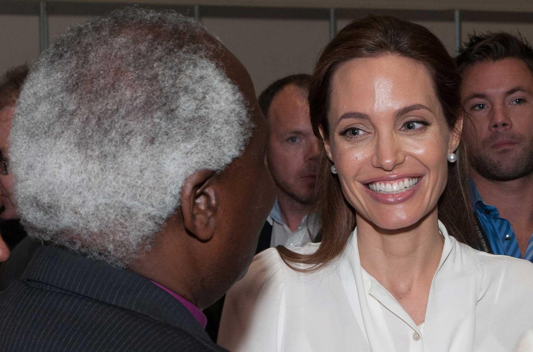 Angelina Jolie greets Archbishop Rwaje